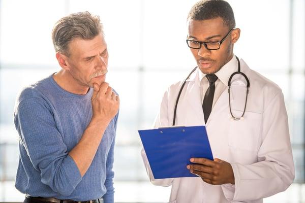doctor-talking-to-patient-men-86598062