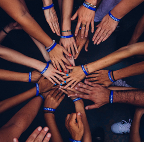 group of people huddling photo – Free People Image on Unsplash