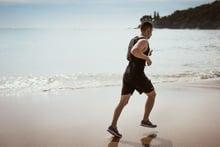 man-wearing-black-tank-top-and-running-on-seashore-1390403-1