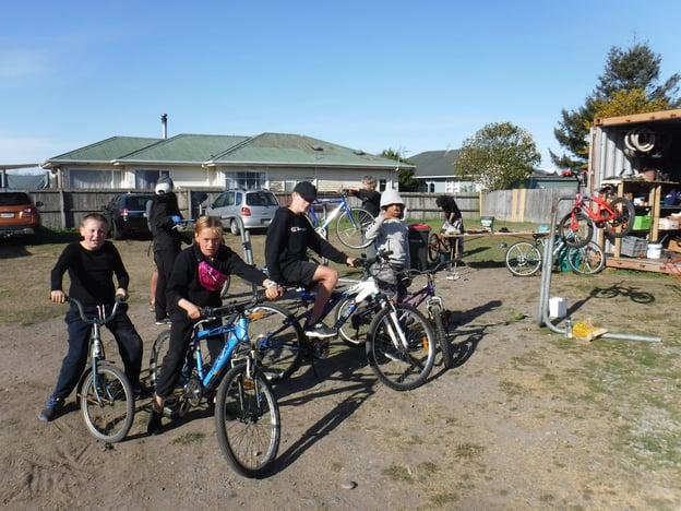 students fix bikes